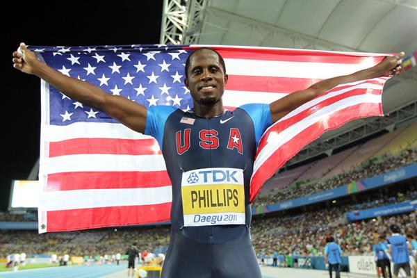 Dwight Phillips of the USA celebrates his fourth World Long Jump title (Getty Images)