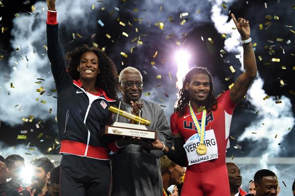 USA captains DeeDee Trotter and David Verburg receiving the Golden Baton from IAAF President Diack at the end of the IAAF/BTC World Relays, Bahamas 2015 (Kirby Lee)