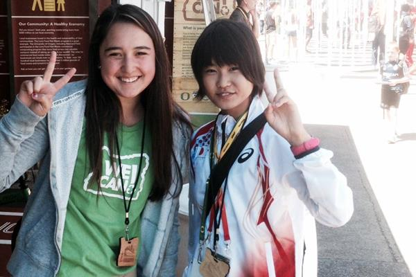 A Japanese athlete visits the We Can! sustainability stand at the 2014 IAAF World Junior Championships in Eugene, Oregon (Shelley Villalobos)