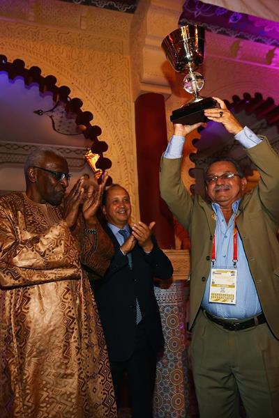 NACAC President Victor Lopez celebrating Team Americas' 2010 IAAF Continental Cup win after being presented with the trophy in Marrakech (Getty Images)