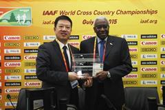 SINOLUBE Party Secretary Guo Lianjie with IAAF President Lamine Diack (Getty Images)