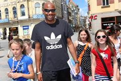 Long jump world record-holder Mike Powell with a group of young fans (Getty Images)