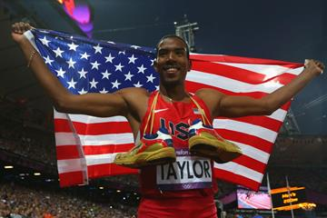 Christian Taylor of the United States celebrates after winning gold in the Men's Triple Jump Final of the London 2012 Olympic Games on 9 August 2012 (Getty Images)