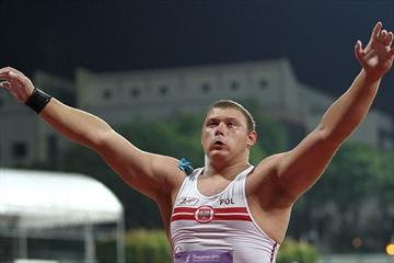 Krzysztof Brzozowski of Poland celebrates winning the boys shot put final at the Youth Olympic Games in Singapore (XINHUA/ SYOGOC-Pool/ Liao Yujie)