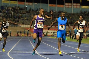 Zharnel Hughes beats Jevaughn Minzie at the 2014 Boys and Girls Championships (Jean-Pierre Durand)