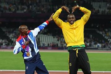 Gold medalist Mo Farah of Great Britain (L) and Usain Bolt of Jamaica have fun on the podium after the medal ceremonies  - London 2012 Olympic Games  on August 11 2012 (Getty Images)