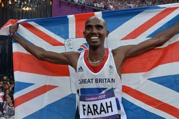 Mo Farah of Great Britain holds a Union flag as he celebrates winning gold in the Men's 5000m Final of the London 2012 Olympic Games (Getty Images)