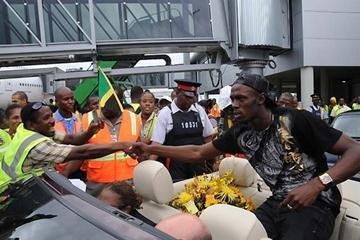 Usain Bolt returns to heroes welcome in Kingston airport (Paul Reid)
