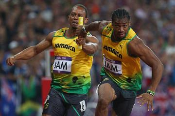 Yohan Blake of Jamaica receives the relay baton from Michael Frater of Jamaica during the Men's 4 x 100m Relay of the London 2012 Olympic Games on 11 August 2012 (Getty Images)