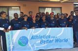 Volunteers and runners behind an ABW banner at the 2014 Geraldine Pillay 5km Fun Run (Organisers)