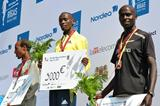 Duncan Koech (centre) with his winner&#39;s cheque after the Nordea Riga Marathon (organisers)