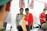 Jackie Joyner-Kersee mixes with the junior athletes in Eugene at the Outreach education display booth (Getty Images)