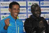 Yemane Tsegay Adere and David Kiyeng at the 2014 Daegu International Marathon press conference (Robert Wagner (organisers))