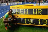 Usain Bolt of Jamaica with the clock showing the new 200m World Record in the Berlin Olympic Stadium (Getty Images)