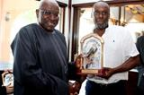IAAF president Lamine Diack presents Bruny Surin with a commemorative crystal trophy (Laurel)