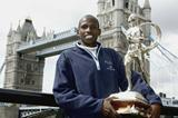 Martin Lel with the Chris Brasher Sporting Life Trophy by London's Tower Bridge (Getty Images)