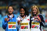 Gold medalist Ajee Wilson (USA) (c)  with Jessica Judd (GBR) (r) and silver medal winner Chunyu WANG (CHN) (l) after the Girls 800 metres final - Day Five - WYC Lille 2011 (Getty Images)