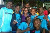 Veronica Campbell-Brown with young athletes in the Bahamas ()