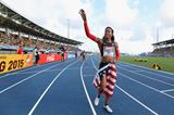 Sanya Richards-Ross of the United States waves to fans as she rounds the track after winning the Women's 4x400 metres relay final  (Getty Images)