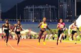 Kelly-Ann Baptiste (centre) wins the Trinidad & Tobago 100m title in 10.83 (Anisto Alves/Trinidad Express)