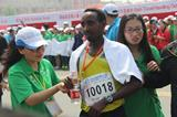 Workneh Tesfa after winning at the 2014 Yellow River Estuary International Marathon (organisers)