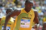 Usain Bolt takes the baton at Penn (Kirby Lee)